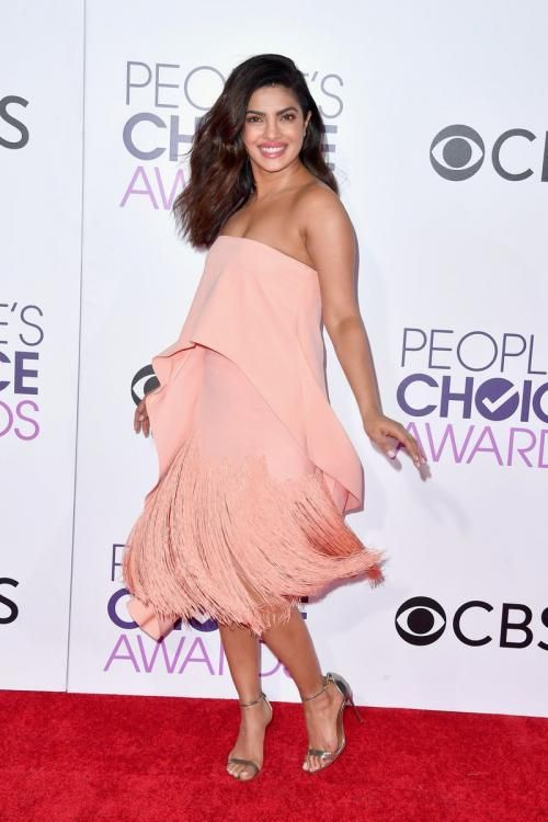 Pretty in Peach! Priyanka Chopra slays the red carpet with her twirls at the PCA's