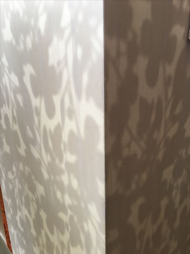 PHOTO 4: Wallpaper in the restaurant at Crown complex. Patterned to resemble shadows from a plant, this wallpaper was visually deceptive. Adds a softness to the space.