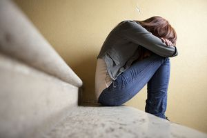 Depressed woman sitting on steps - Angelika Schwarz/E+/Getty Images   living with BPD ~ symptoms