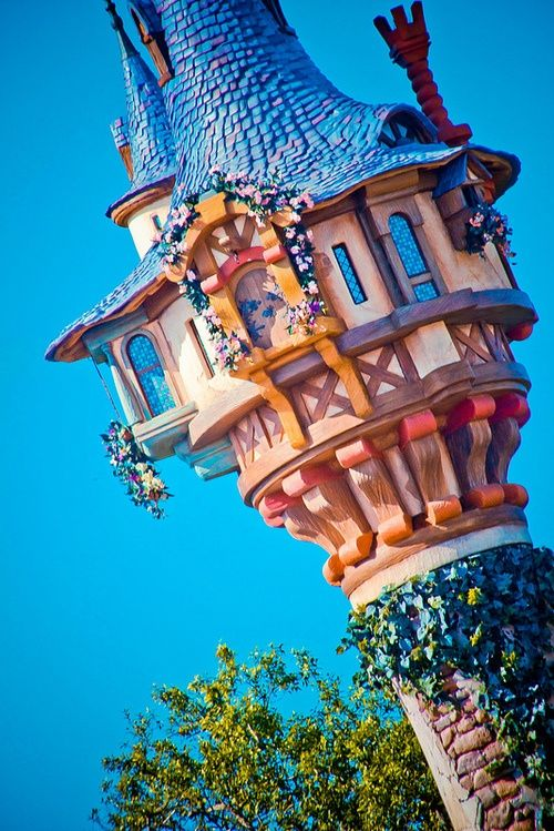 This is a photo of Rapunzel's Tower that is located on the edge of Fantasy Land near Haunted Mansion.  Unfortunately you are unable to go in the tower, but the Imaginers built a cute rest area themed from the movie around the tower.