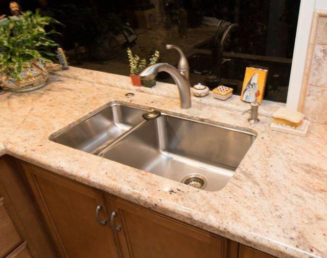 70/30 split stainless steel sink in Golden Ivory granite with Kohler ...
