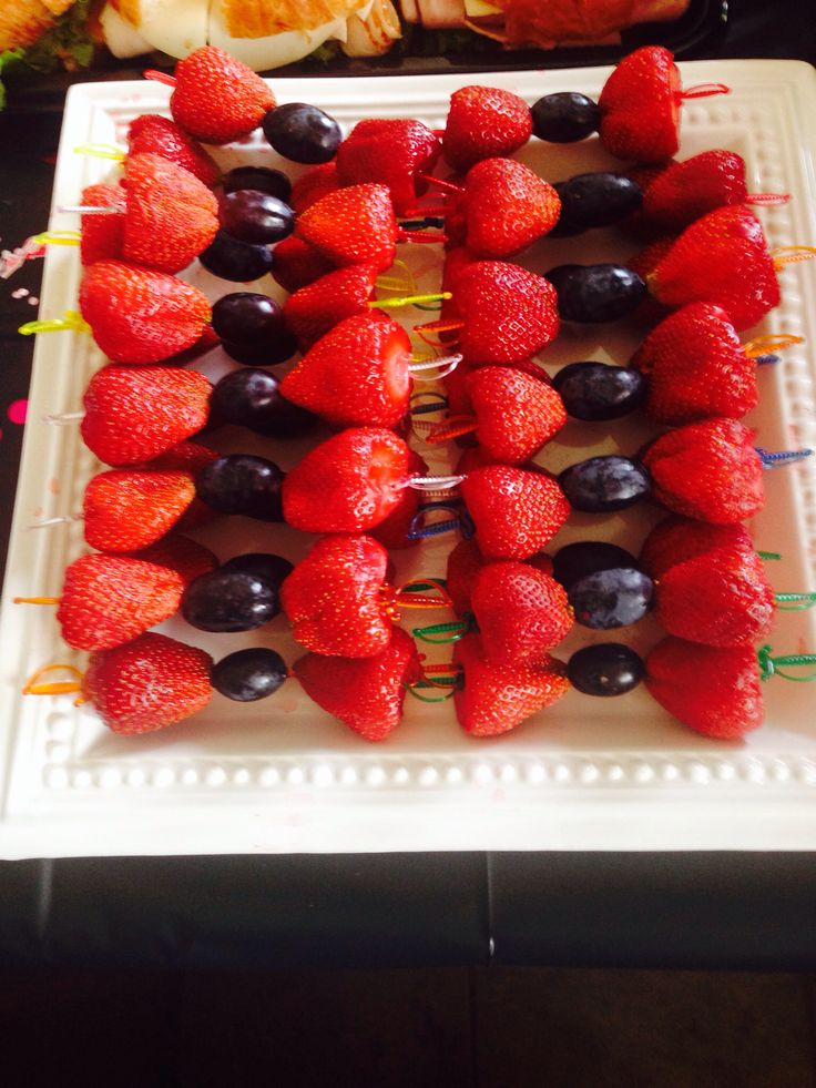 Strawberries and grapes for bow ties - very cute and super easy for a shower!