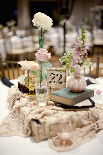 Use of bud vases helps keep the floral budget down and still makes a gorgeous impact for the look you're going for