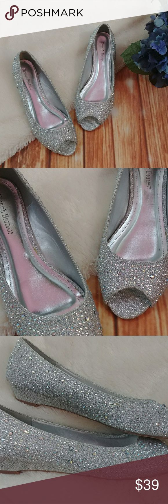 "David's Bridal Low Wedge Peep-Toe with Crystals Add a little sparkle and shine to your ensemble with these low, peep-toe wedges, adorned with iridescent crystals.   -Synthetic -Wedge height: 1"" -Like new condition, soles a little dirty from being tried on but never worn outside. David's Bridal Shoes Wedges"