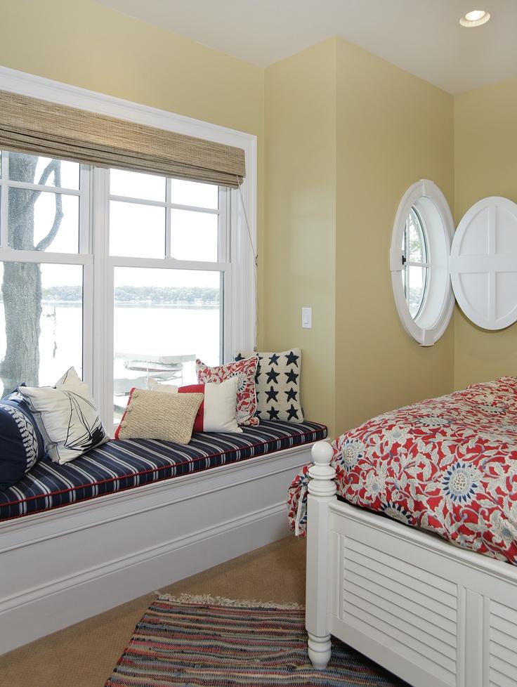 Window seat overlooks lake. Porthole window with custom-made shutter