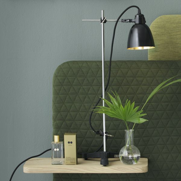 ALKYMIST Industrial table lamp with black metal pendant in cobbler or brass. All components are original lab-equipment and have the flexibility and solid quality that characterizes lab-equipment.   Contains: Black cast iron base: Ø220 Chrom center rod: ø10 × 600 2 pcs. bosshead 1 pc. tripod clamp Metal pendant, black painted exterior: choose between copper or brass Fabric cable with switch, 3 meters  Comes in a gift box  CE approved www.kemikaze.dk Picture credits: Eckmannstudio