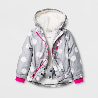 This toddler girl hooded windbreaker features a sherpa lining with an allover large white dot pattern and a bright pink zipper for a pop of color.