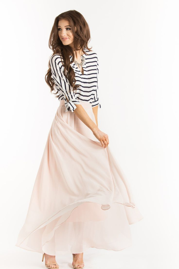 Our favorite skirt now is now back in stock in a pretty light pink! This maxi skirt is all you could have asked for and more! With flowy layers, a flattering silohuette and gorgeous light pink color,