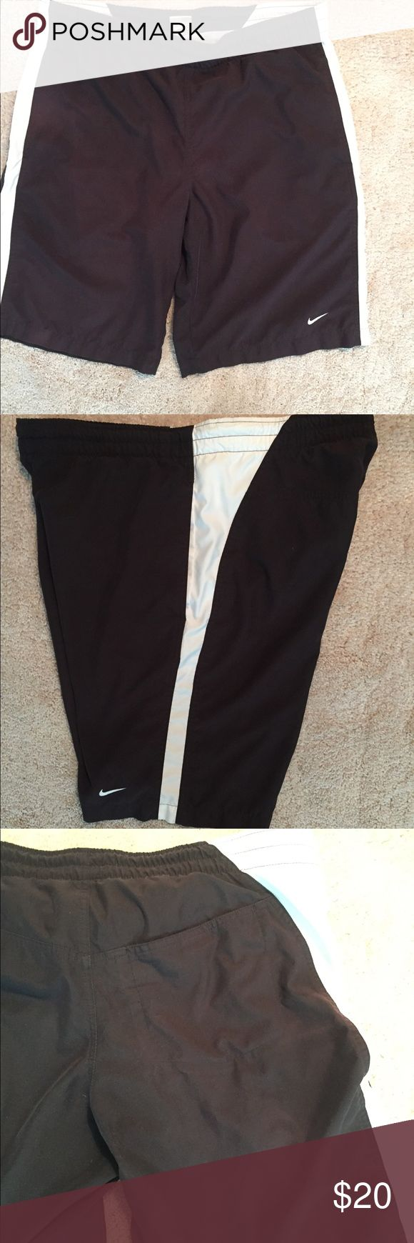 Men's Nike swim shorts I have for sale a black pair of Nike swim trunks. The shorts are size medium, and have a white stripe down the sides. The shorts have netting, and a back Velcro pocket. Great shape. Drawstring still in waistband. Nike Swim Swim Trunks