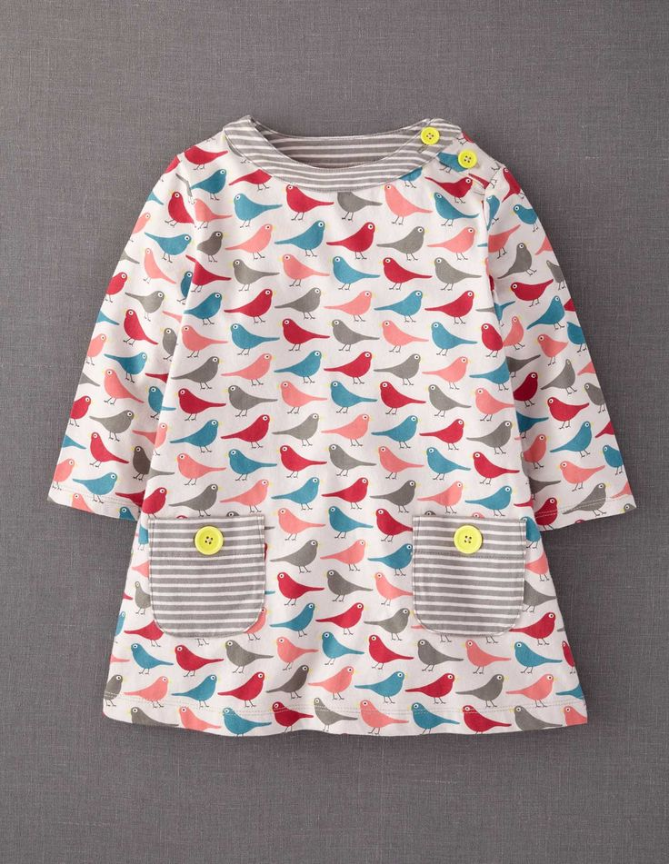 (Jenni) Amazing what some cute bright buttons can do for a darling little tunic. #Idea #Inspiration #Kids