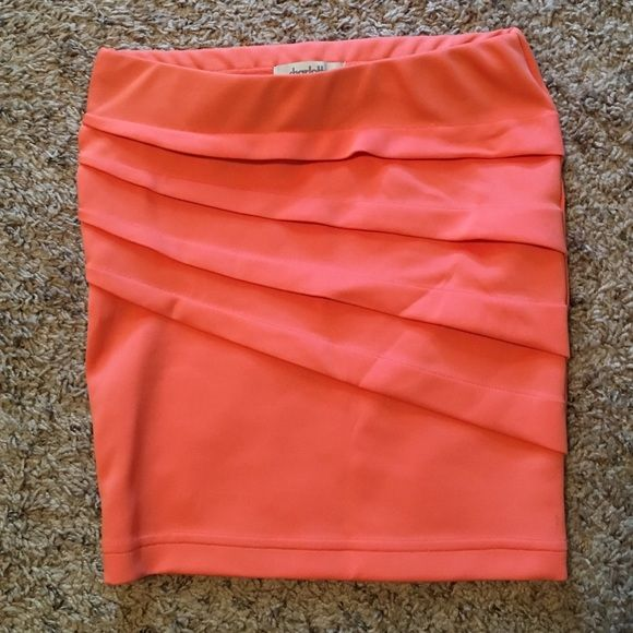Like new, bright going out skirt This super cute skirt is perfect for going out to bars or to dinner. It hugs tight on the body. It has been lightly worn, but is not noticeable. Charlotte Russe Skirts Mini
