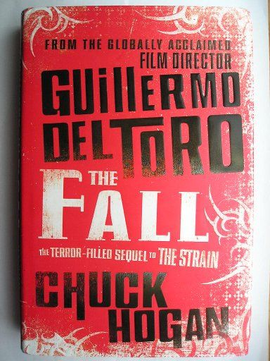 "The novel ""The Fall"" by Guillermo del Toro and Chuck Hogan was published for the first time in 2010. It's the second novel in the Strain trilogy and is the sequel to ""The Strain"". Image of the cover of a British edition. Click to read a review of this novel!"