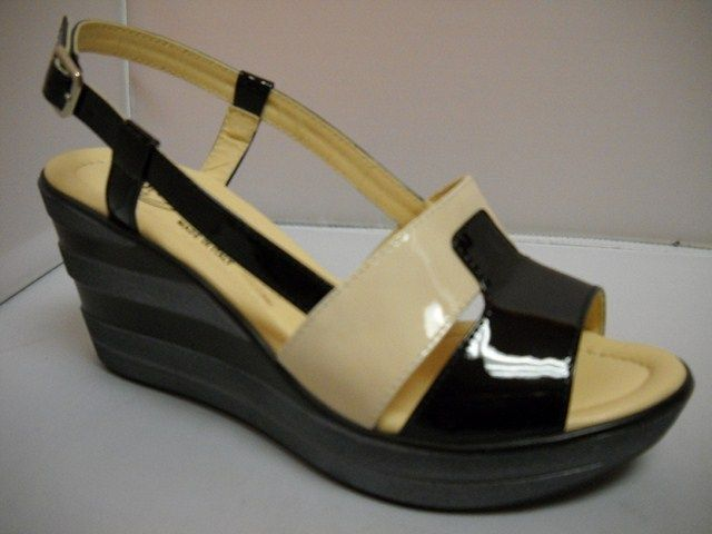 Donna Soft from Italy.  Patent slingback with 8cm layered wedge.  Available in Black/Yellow and Black/marble.    Sizes range 36-41