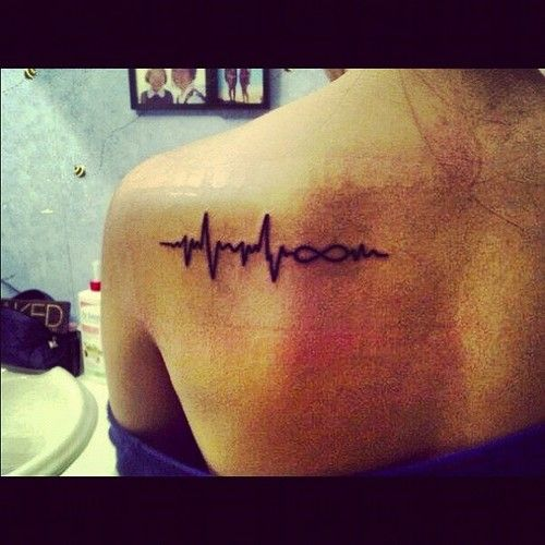Heartbeat tattoo with an infinity symbol in the middle. So perfect.