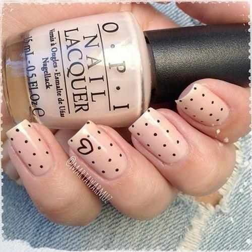 Nude base with small black polka dots. Ring finger has thin black heart.