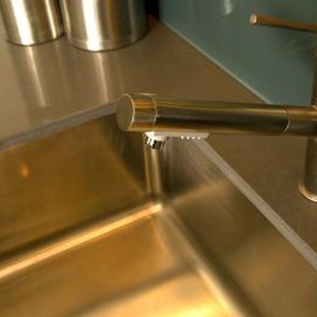 Remove water spots from your stainless steel sink to restore the sink to its original condition.
