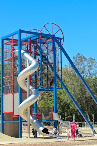 Not normally my cup of tea (for a start I think steel is a crazy material to be using in Australia's hot climate, and why does everything in playgrounds have to be in primary colours?), but just the sheer size of this slide and tower (9 metres) is great.  In the Lake Macquarie Variety Playground, in NSW, Australia.