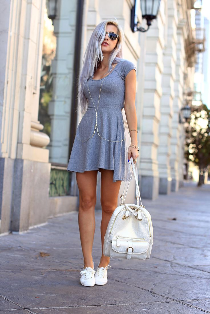 Evelina Barry Is Wearing A Grey Dress By Brandy Melville, A Backpack From Sorial, Shoes From Keds Bodychain And Sunglasses From Warby Parker...