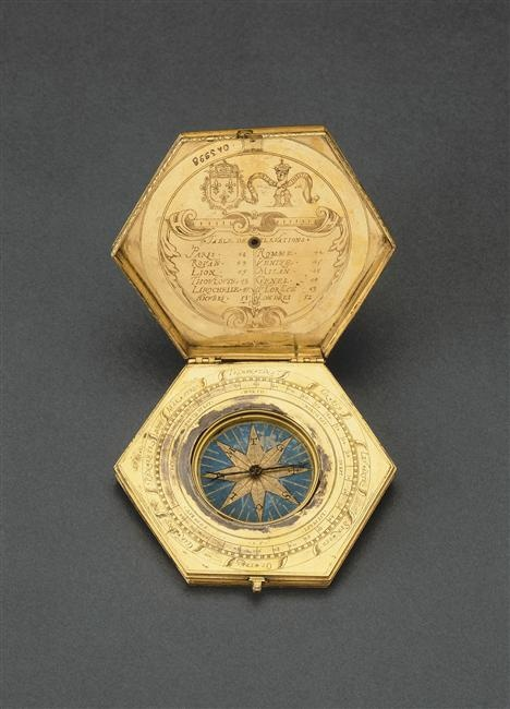 French astronomical compendium ~ Includes the coat of arms and motto of Charles X.  It is composed of a nocturnal, a list of latitudes in degrees of twelve cities in Europe, a compass, an azimuth pinnules (for sighting), and a double scale to assist in the measurement of the unequal hours in a day throughout the year - dates to 3rd quarter of the 16th century. (1st of two pins, Louvre)