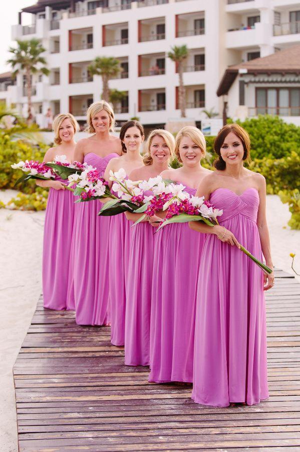 Glamorous Fuschia bridesmaid dresses: http://www.stylemepretty.com/destination-weddings/mexico-weddings/2016/03/25/glamorous-fuchsia-wedding-at-secrets-playa-mujeres/ | Photography: Melissa Mercado - http://melissa-mercado.com/