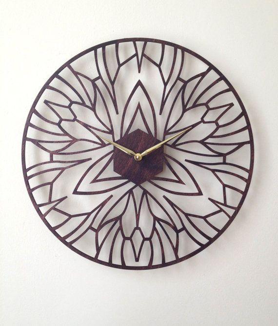 THIS for Dad: (Iris, his fav flower) Iris Clock. Modern Laser Cut Wood Wall Clock. by SarahMimoClocks