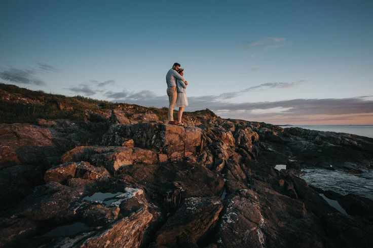 we want to be on top of the world, just like this Norwegian couple | Image by Joanna Jaskólska Fotografia