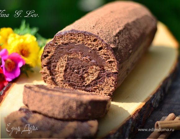 """Рулет """"Трюфель"""" (Truffle)-яйца - 4 шт. + 1 белок  -мука - 100 г  -сахар - 150 г  -шоколад черный (78% какао) - 55 г  -лимонный сок - пару капель  ,,,,,,,,,,,,,,,,,  Для крема  -сливки жирные 35 % - 400 г  -шоколад черный (78 % какао) - 200 г  -сахарная пудра - 2 ст.л.  -кофе растворимый - 2 ч.л."""