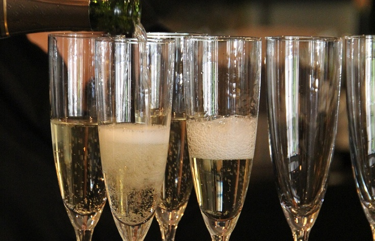 Champagne flutes filled with Traditional Spanish Cava (sparkling white wine) #beavercreek #champagne #Cava #cheers