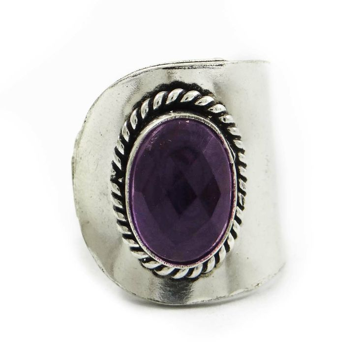 This is a beautiful Silvertone metal ring which is studded with stone. It is a high quality fashionable ring. ..this is img