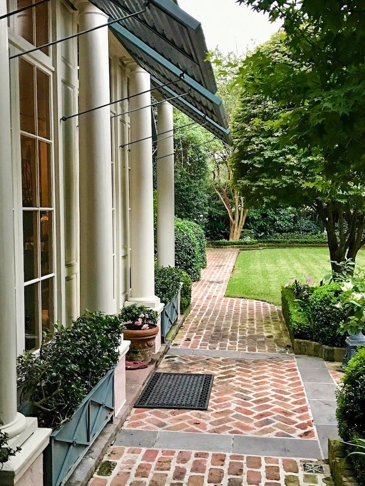 Inspiring Garden Design: 11 Tips for Creating a Courtyard - Use bricks to elevate flower beds