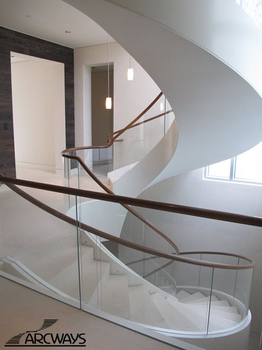 Staircase created using stone steps and glass railings.  The LED lights add even more drama.