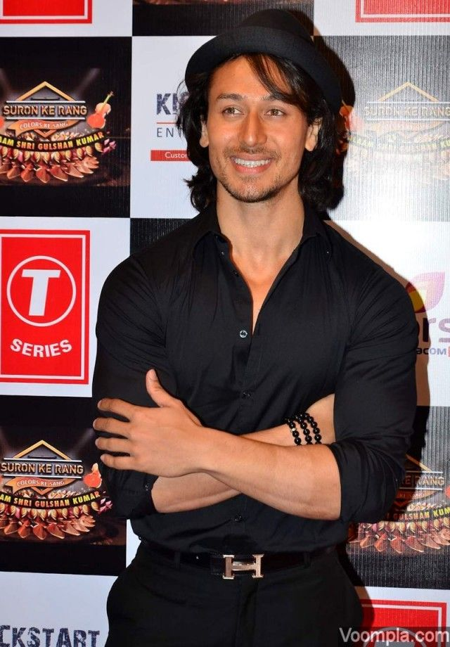 Tiger Shroff in black shirt pants and hat on red carpet