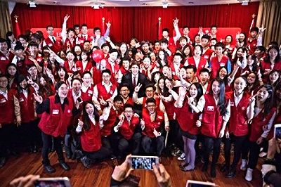 "Justin Trudeau is surrounded by scores of ""Tru-Youths"", whose organization was based in Michael Ching's Richmond office. The event, which Tru-Youths United helped stage, was a December 17, 2014, community Christmas party that turned into a surprise birthday party for Trudeau, attended by 2,000 people. Photo: Twitter"