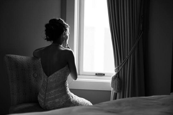 Bride looking through the window.