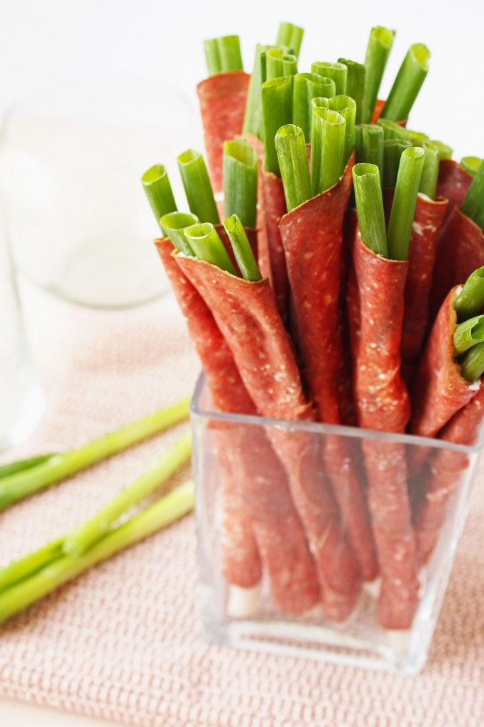 Scallion Straws...wow! scallions wrapped in dried beef with cream cheese in a vase! Could wrap in italian salami too!
