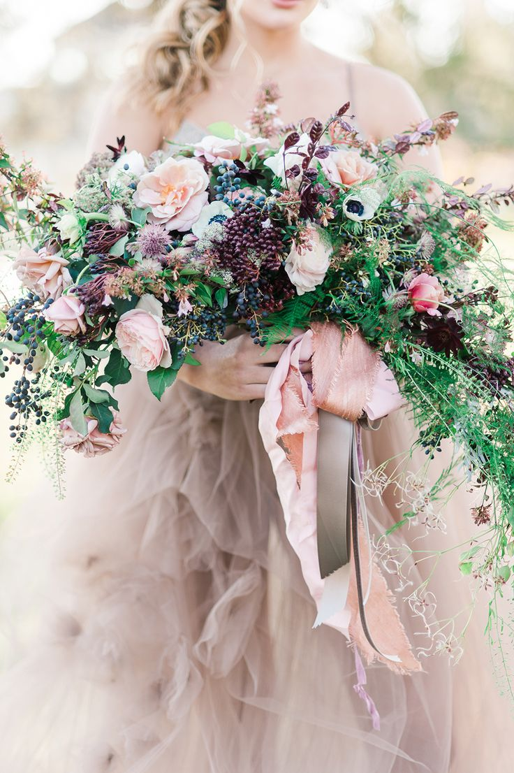 This brides wild flower bouquet offers a unique way to include the woodland, ethereal theme to a wedding. See more woodland ethereal wedding ideas here: http://ruffledblog.com/ethereal-wedding-inspiration-with-vintage-accents/