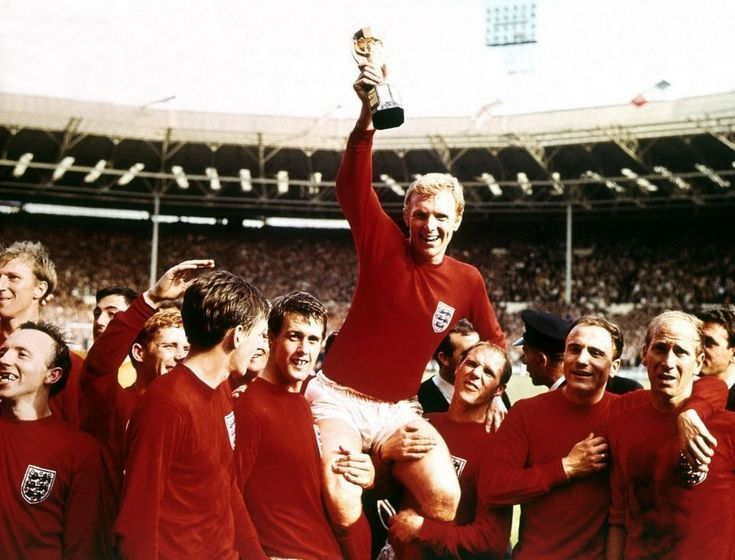England captain Bobby Moore lifts the Jules Rimet trophy as he sits on the shoulders of his team-mates (from left) Jack Charlton, Nobby Stiles, Gordon Banks, Alan Ball, Martin Peters, Geoff Hurst, Ray Wilson, George Cohen and Bobby Charlton