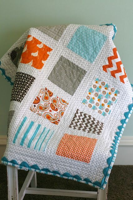"""Modern Baby quilt - squares were cut at 6 1/2"""". sashing was cut at 2 1/2"""". outer border was cut at 4"""". Used jumbo ric rac under binding."""