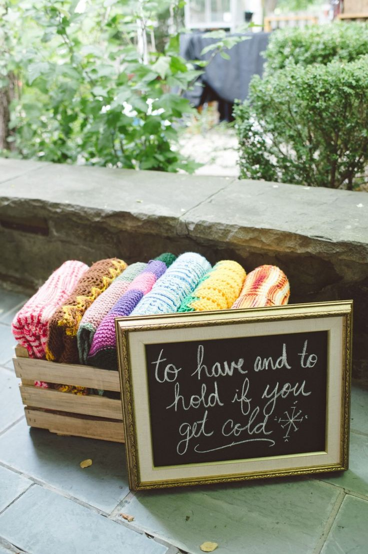Having blankets on hand is a great idea for a fall wedding.