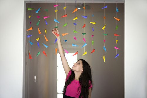 Hanging mini paper airplanes for a farewell party