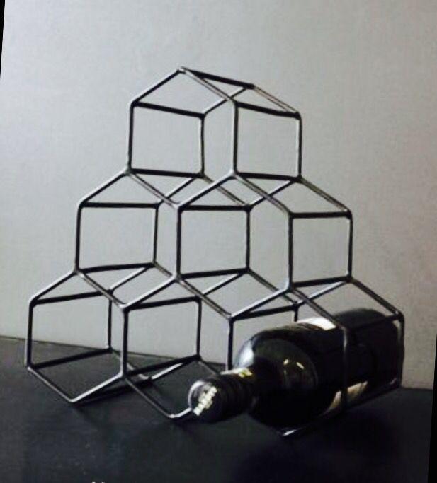 Black geometric wire wine rack by Rockett St George