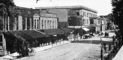 Downtown Lake City, Marion Street with the Blanche Hotel, shops, and restaurants as Meg and DeWitt would have known them.