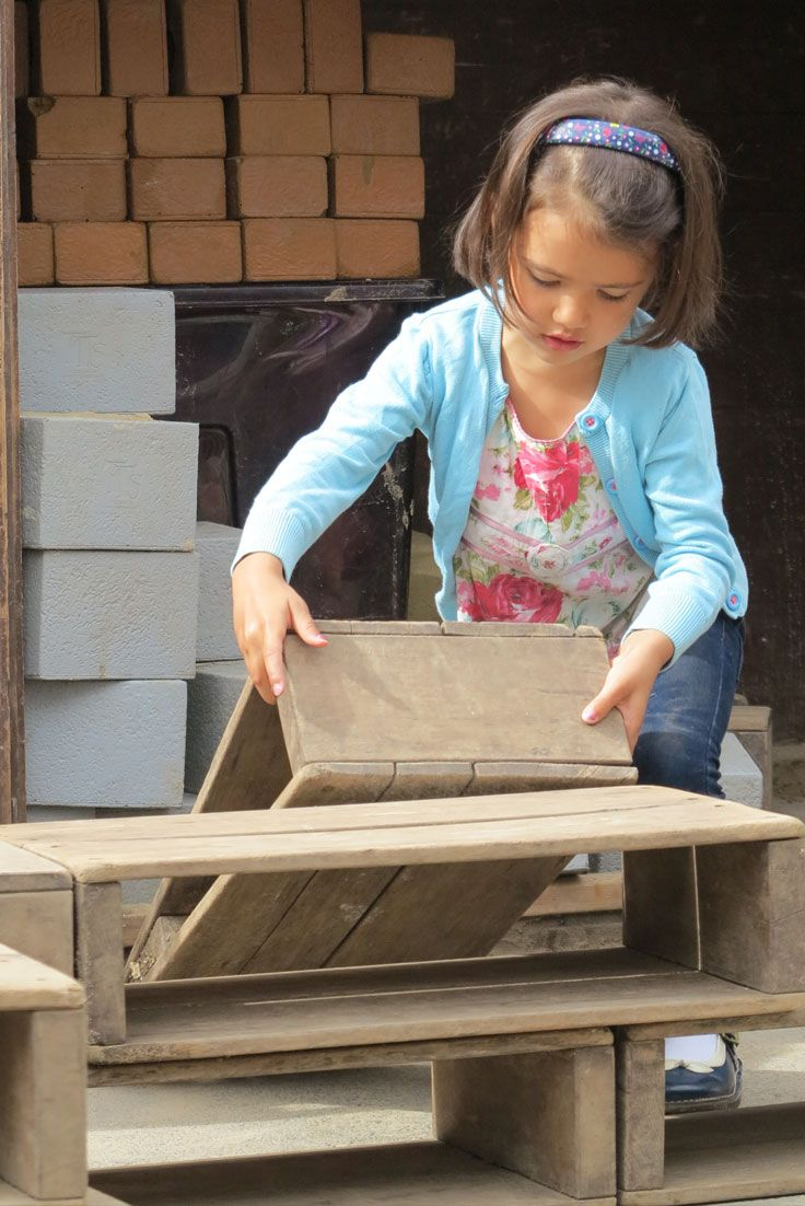 Hollow block play invites total involvement and provides physical exercise for older children.
