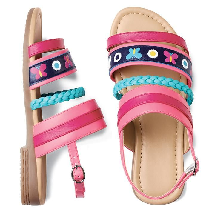 Adorable sandals with a fun floral and butterfly print. Blue braided detail on front. Adjustable ankle strap. Man-made materials.