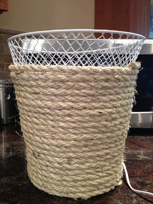 dollar store waste basket makeover, bathroom ideas, crafts, repurposing upcycling, Use a hot glue gun to wrap it with rope