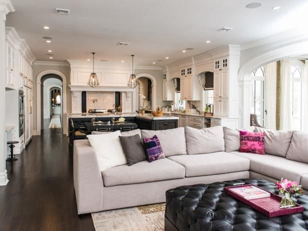 Room to Room in Modern Gray Home Remodel from HGTV - love the detail...arched doorways, custom cabinets