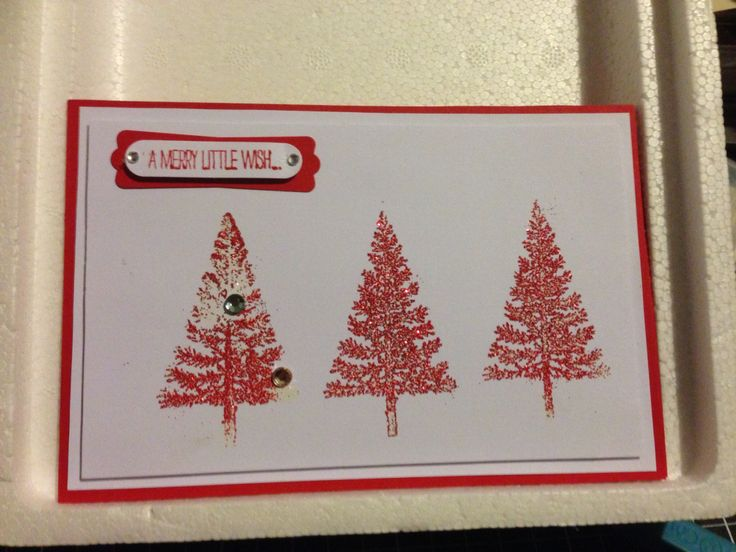Xmas handmade card. First time using emboss powder had a glitch or two but still wanted to share. Had fun.