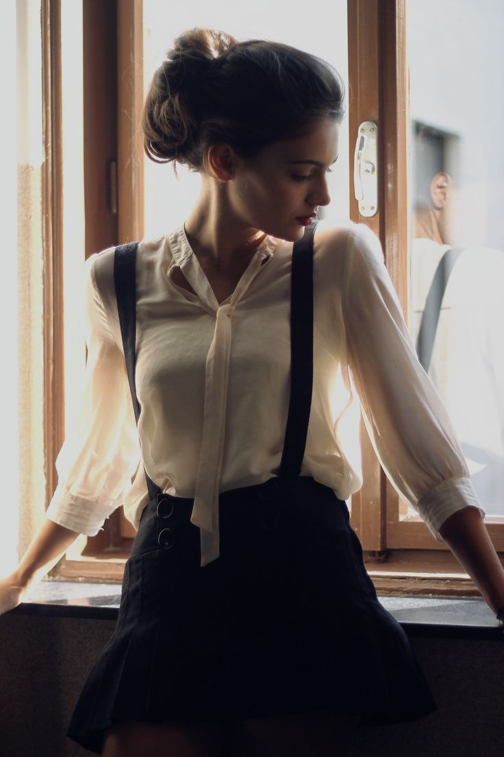 Melancholie Soul: cream blouse, high-waisted black miniskirt w/ black shoulderstraps, black hair done up, red lips
