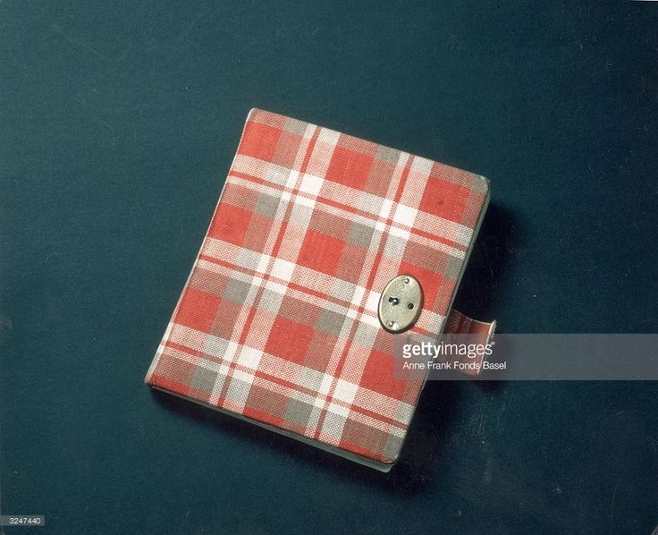 Still life of Anne Frank's red plaid diary, her first journal, in which she wrote from 1942 to 1944.