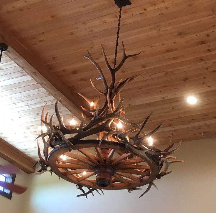 Wagon wheel/antler chandelier